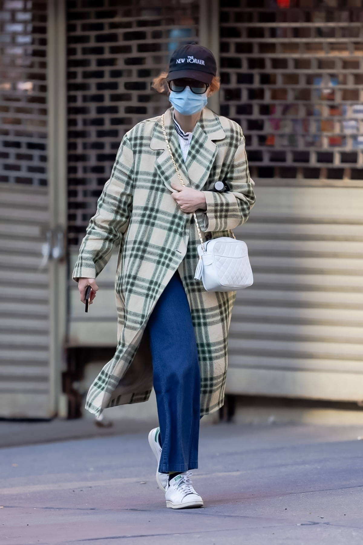 Jennifer Lawrence bundles up in a plaid overcoat as she steps out in New York City