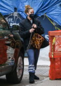 Jennifer Lawrence keeps it cozy in a black jacket and blue sweatpants while out running errands in in New York City