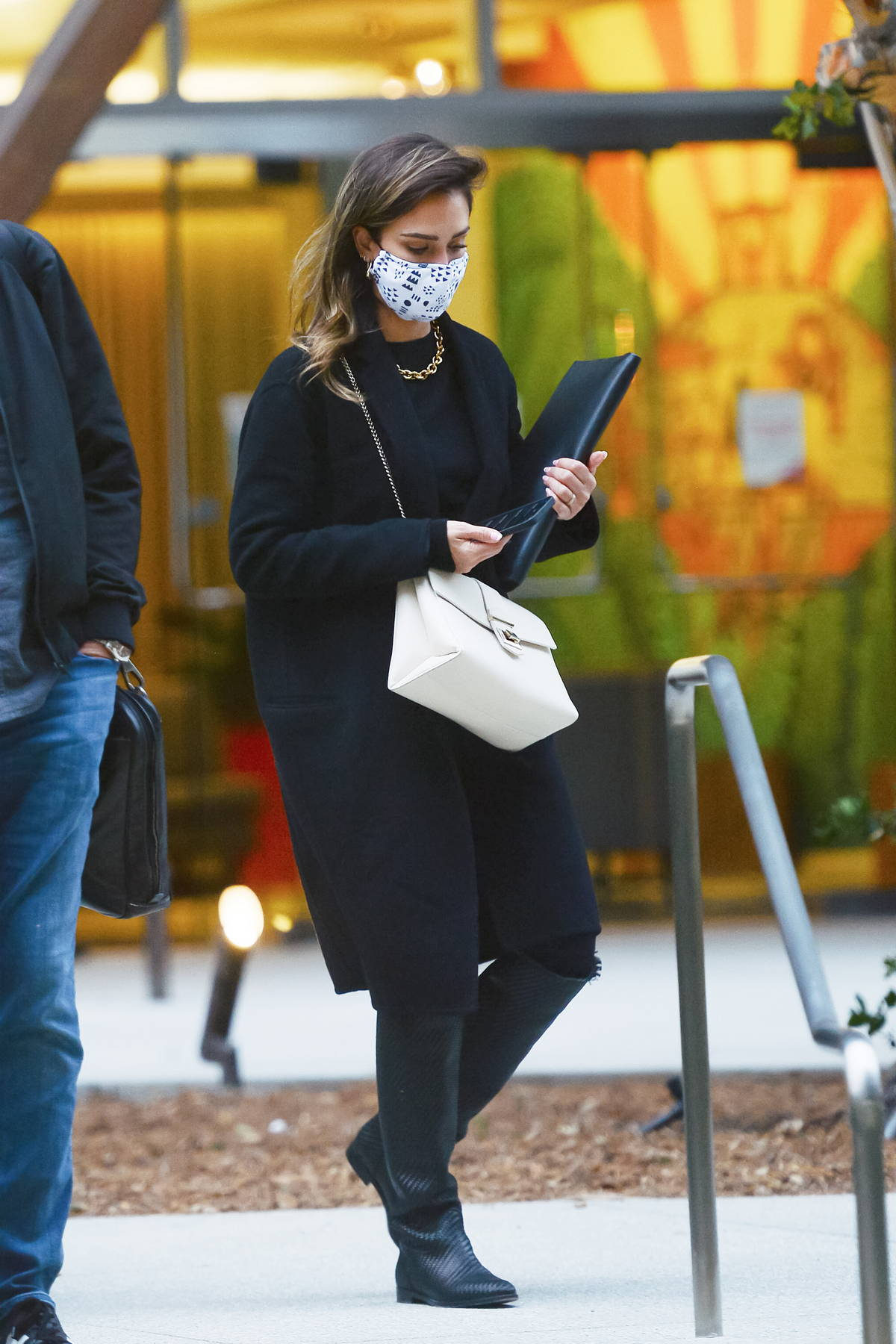 Jessica Alba looks fashionable in all-black while stepping out of an office building in Los Angeles