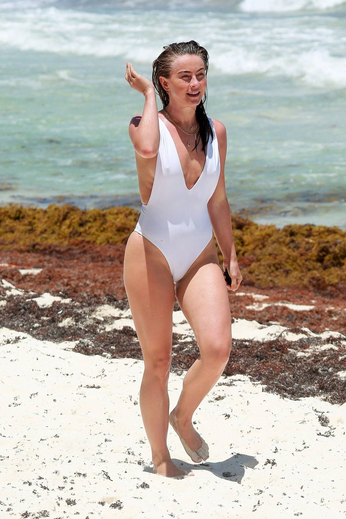 Julianne Hough heats up the beach in a white swimsuit as she continues her vacation in Tulum, Mexico