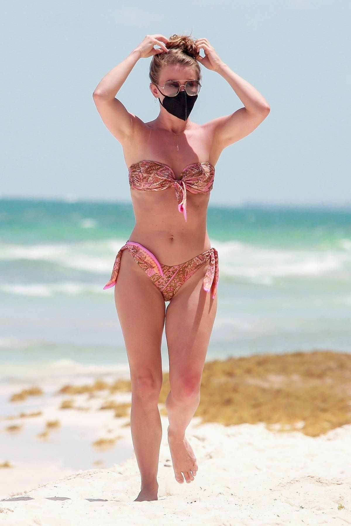 Julianne Hough shows off her toned body in a printed pink bikini while enjoying a beach day in Tulum, Mexico