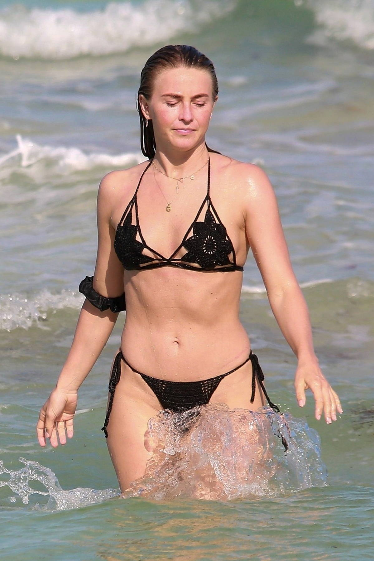 Julianne Hough stuns in a black crochet bikini while enjoying a beach day with friends in Tulum, Mexico
