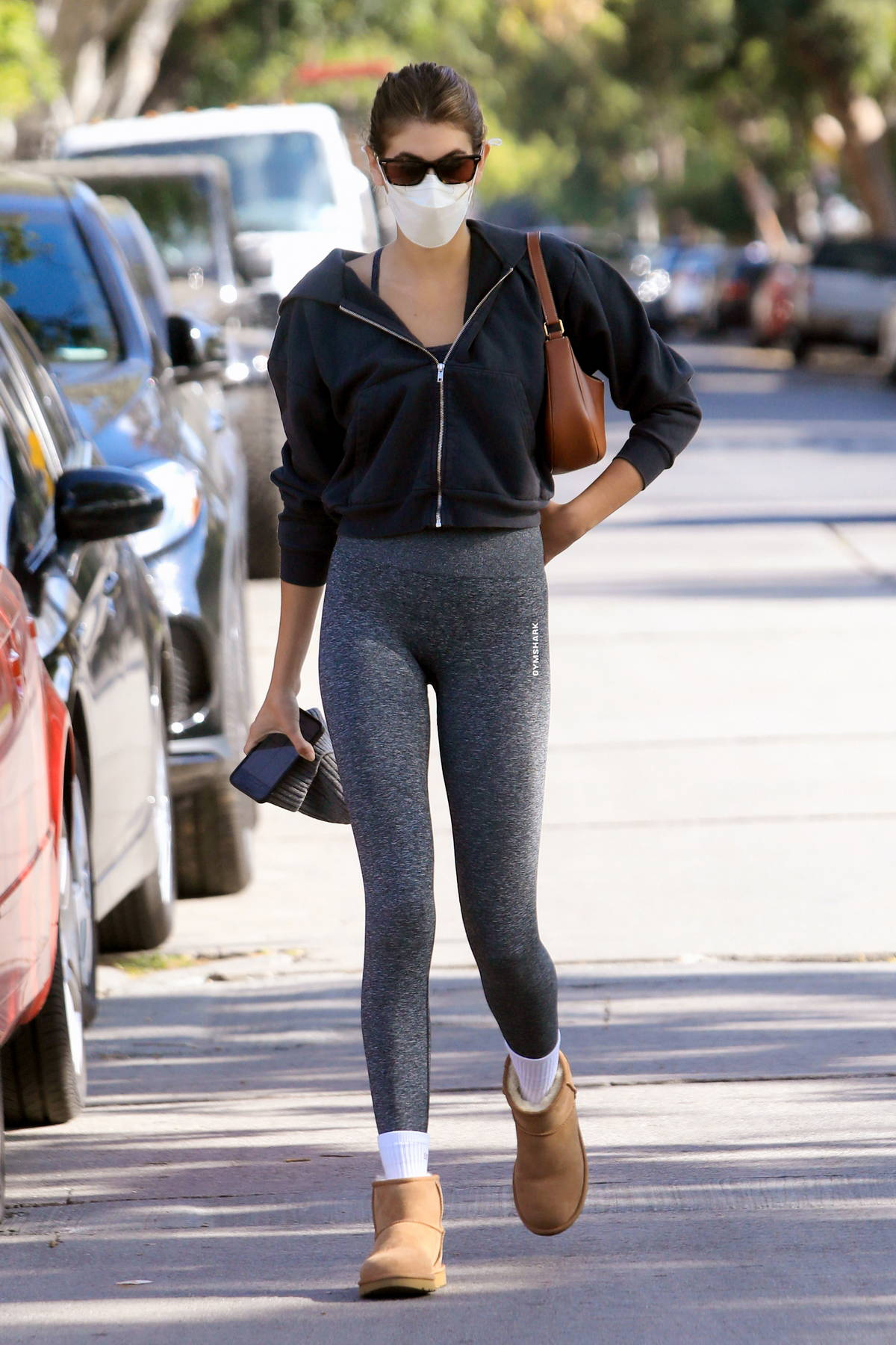 Kaia Gerber flaunts her long legs in heather-grey leggings as she hits her morning Pilates class in West Hollywood, California