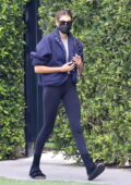 Kaia Gerber seen leaving after her Pilates session wearing a navy teddy jacket and leggings in West Hollywood, California