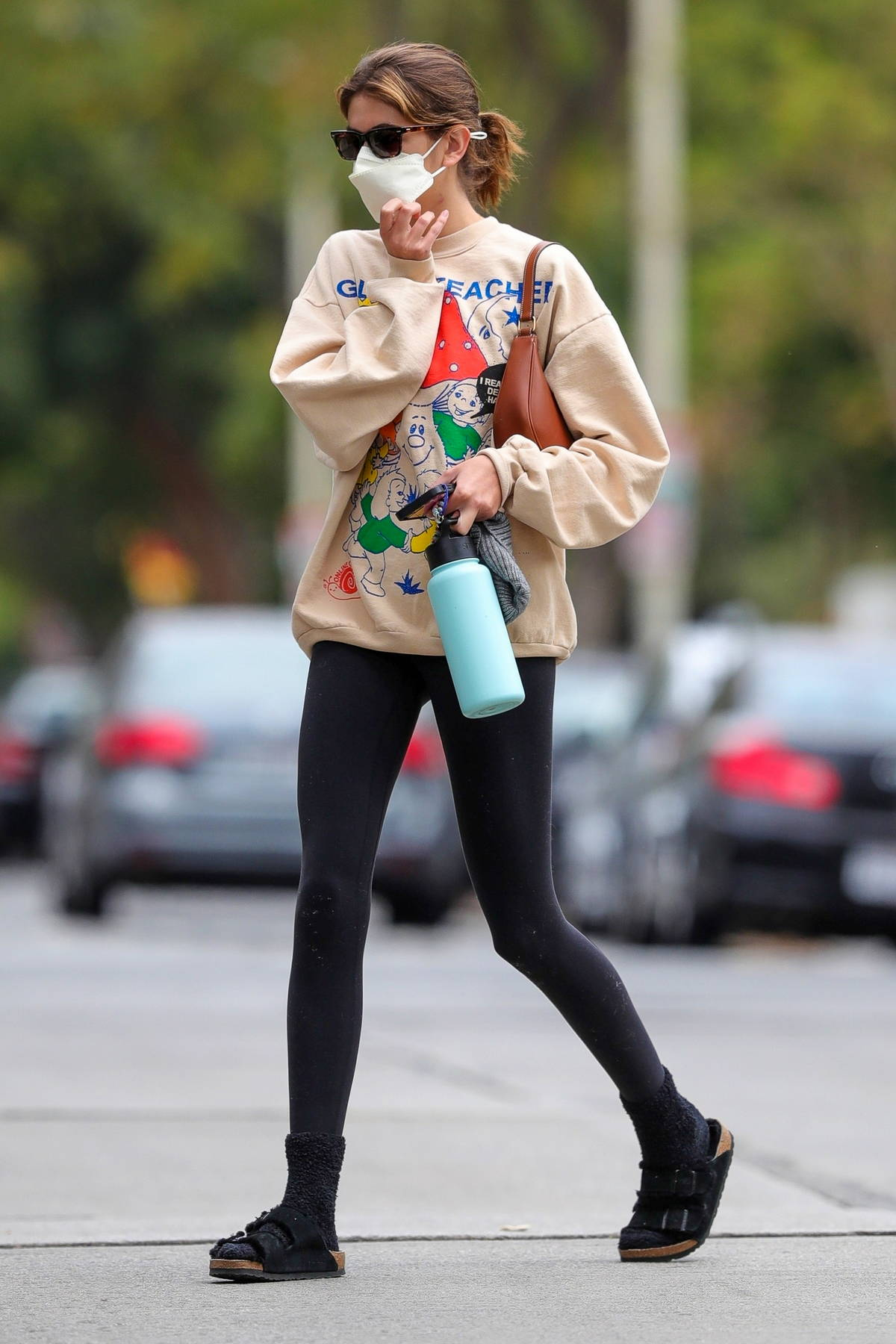 Kaia Gerber sports a beige sweatshirt and black leggings as she attends her Pilates class in West Hollywood, California