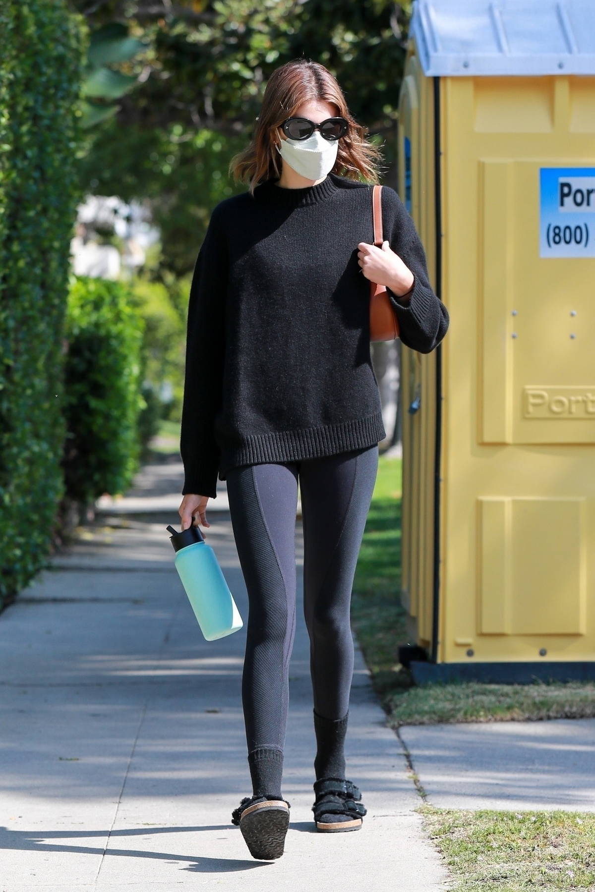 Kaia Gerber sports all-black sweater and leggings as she attends her Pilates class with a friend in West Hollywood, California