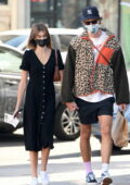 Kaia Gerber wears a buttoned-up black dress while making a grocery run with Jacob Elordi in Los Angeles