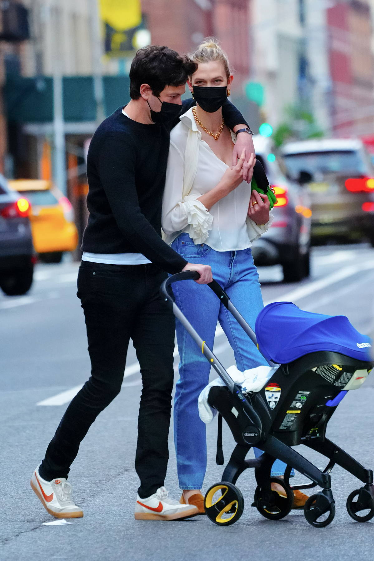 Karlie Kloss and Joshua Kushner step out with their newborn baby as they enjoy a stroll in New York City