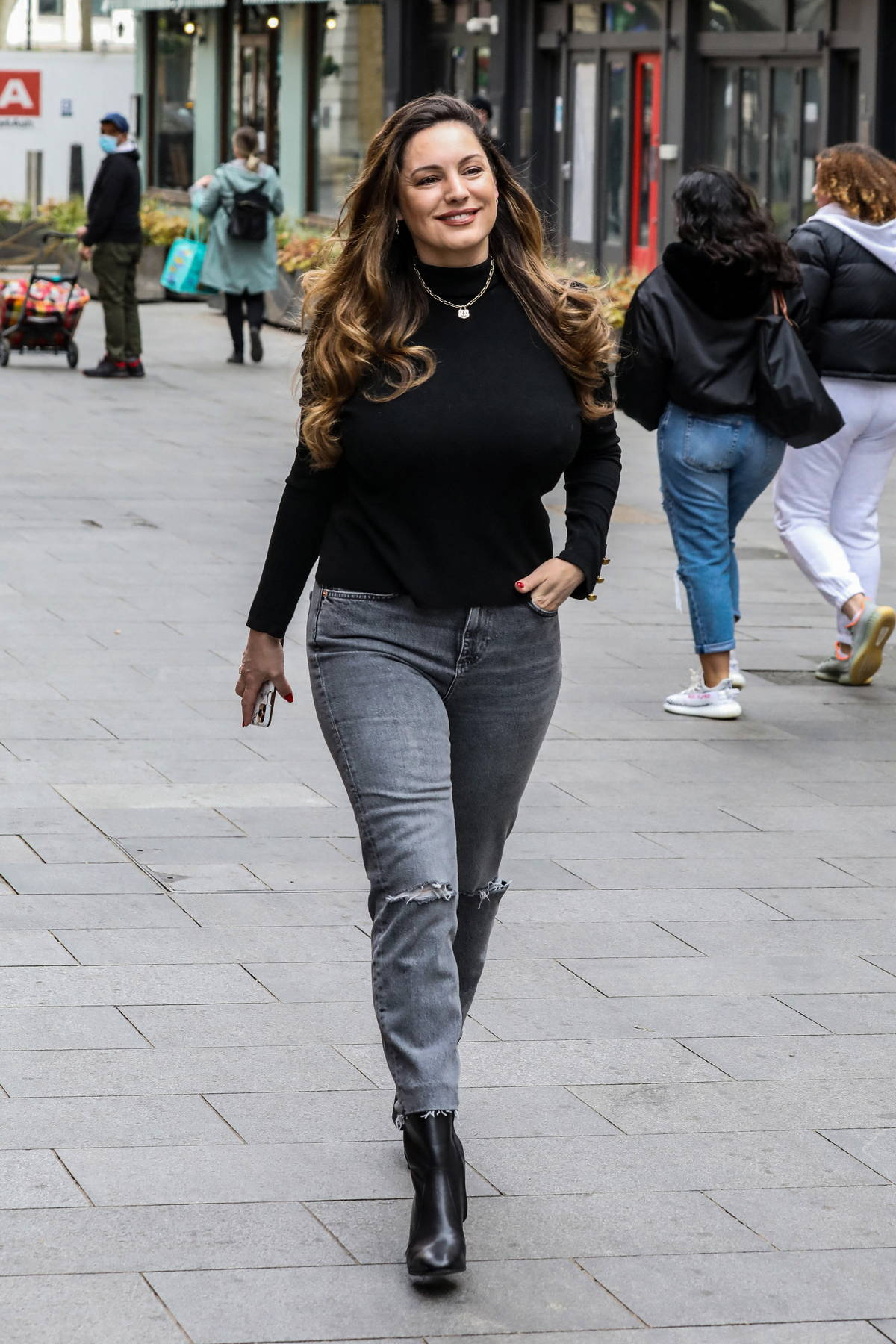 Kelly Brook is all smiles as she for her Heart FM show at the Global Radio Studios in London, UK