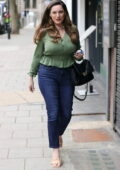 Kelly Brook looks amazing in a stylish ruffled green shirt and jeans at Heart Radio in London, UK