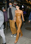 Kendall Jenner looks stunning in a brown vinyl outfit while enjoying a night out with Devin Booker in New York City