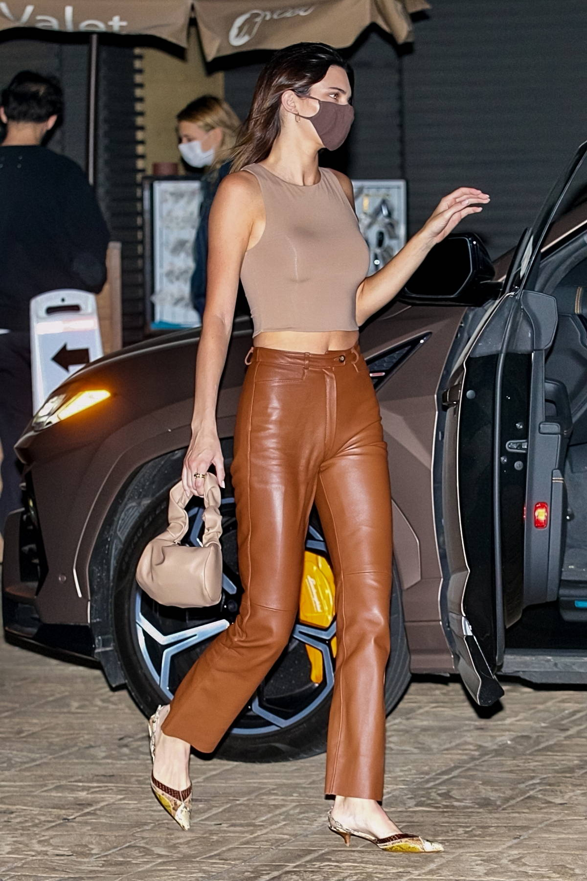 Kendall Jenner looks stylish in brown leather pants and a beige crop top while out to dinner at Nobu in Malibu, California
