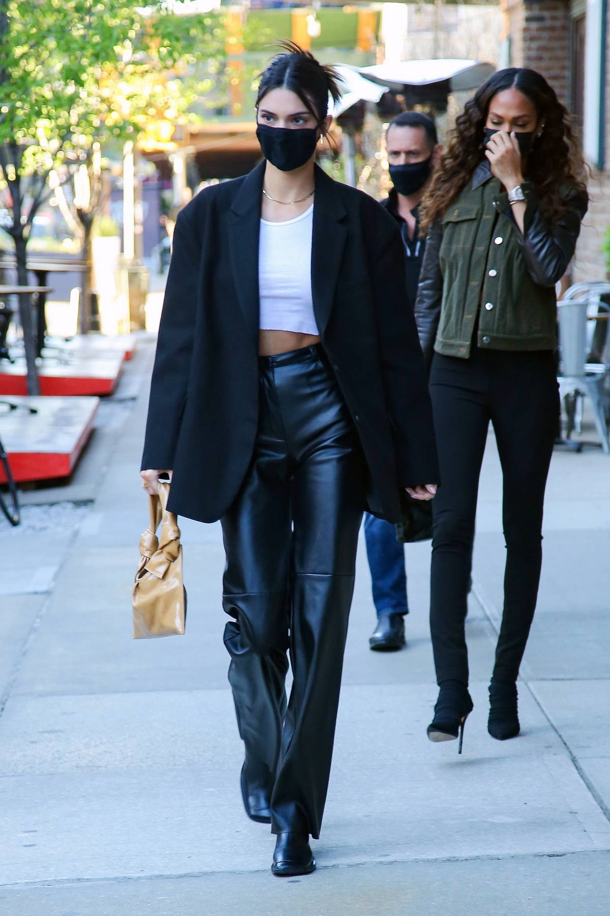 Kendall Jenner looks super chic in black leather pants with matching blazer while heading out with Joan Smalls in New York City