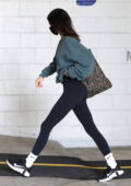 Kendall Jenner sports an oversized sweatshirt with leggings as she heads for a workout session in West Hollywood, California