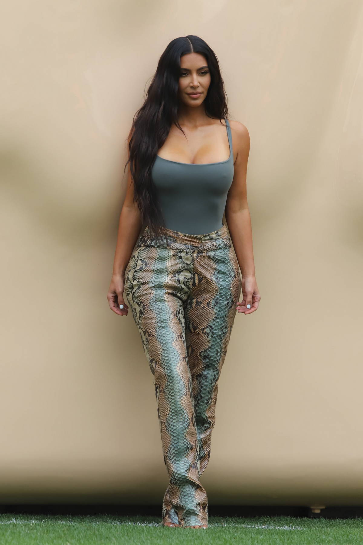 Kim Kardashian puts on a curvy display as she surprises fans at her SKIMS pop up shop at the Grove in Los Angeles