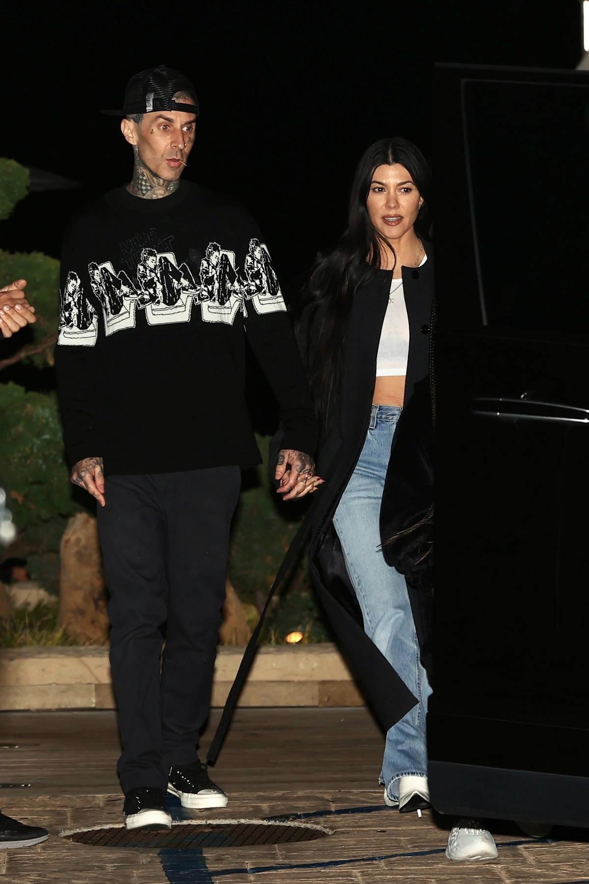 Kourtney Kardashian and Travis Barker bring Kourtney's daughter Penelope and Kim's daughter North to dinner in Malibu, California