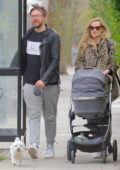 Laura Whitmore and husband Iain Sterling step out for a walk with their newborn daughter in London, UK