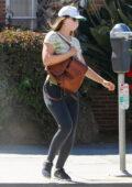 Leighton Meester wears a tie-dye tee and black leggings while running a few errands in Santa Monica, California