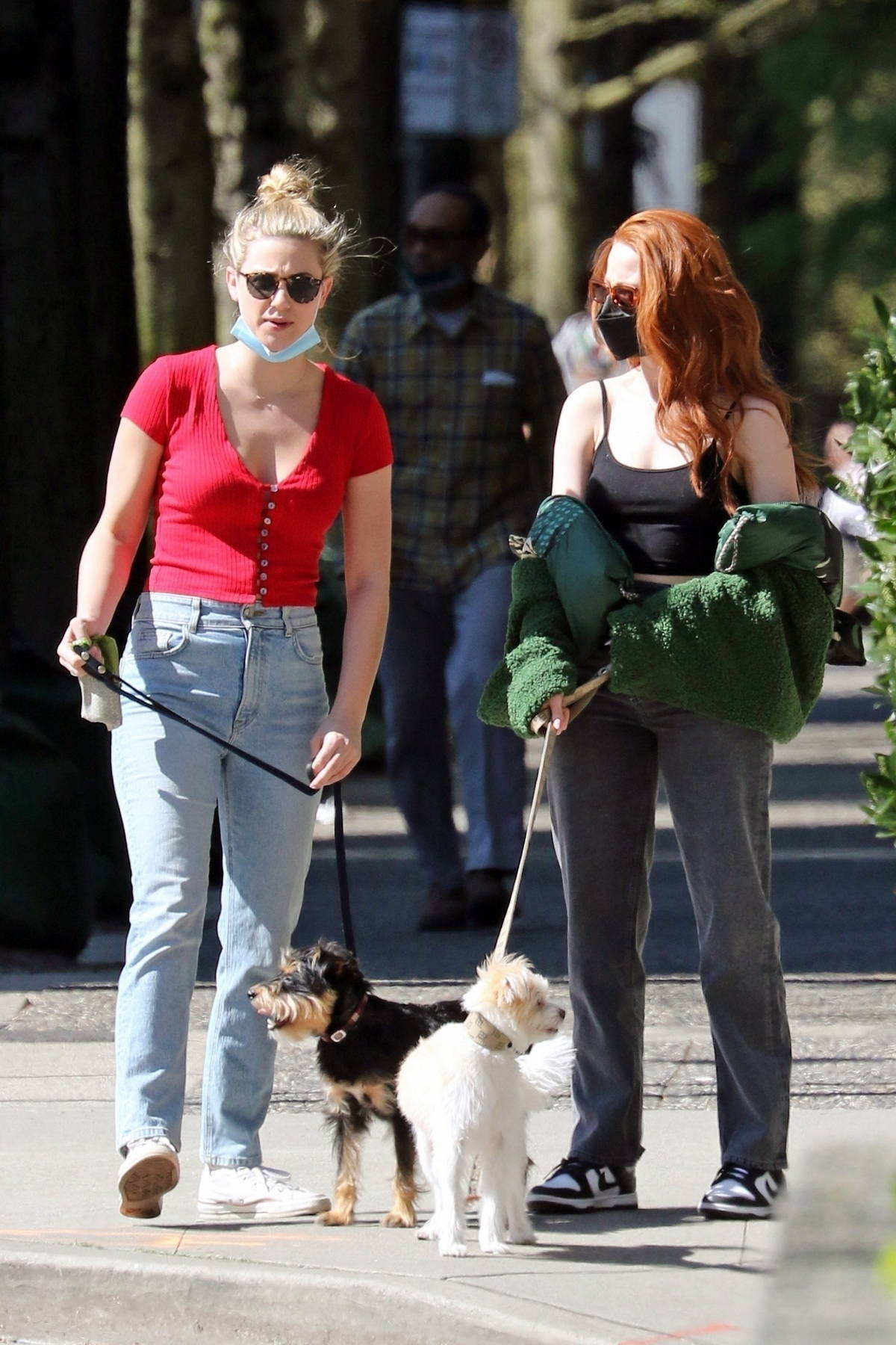 Lili Reinhart and Madelaine Petsch step out to walk their dogs in Vancouver, Canada