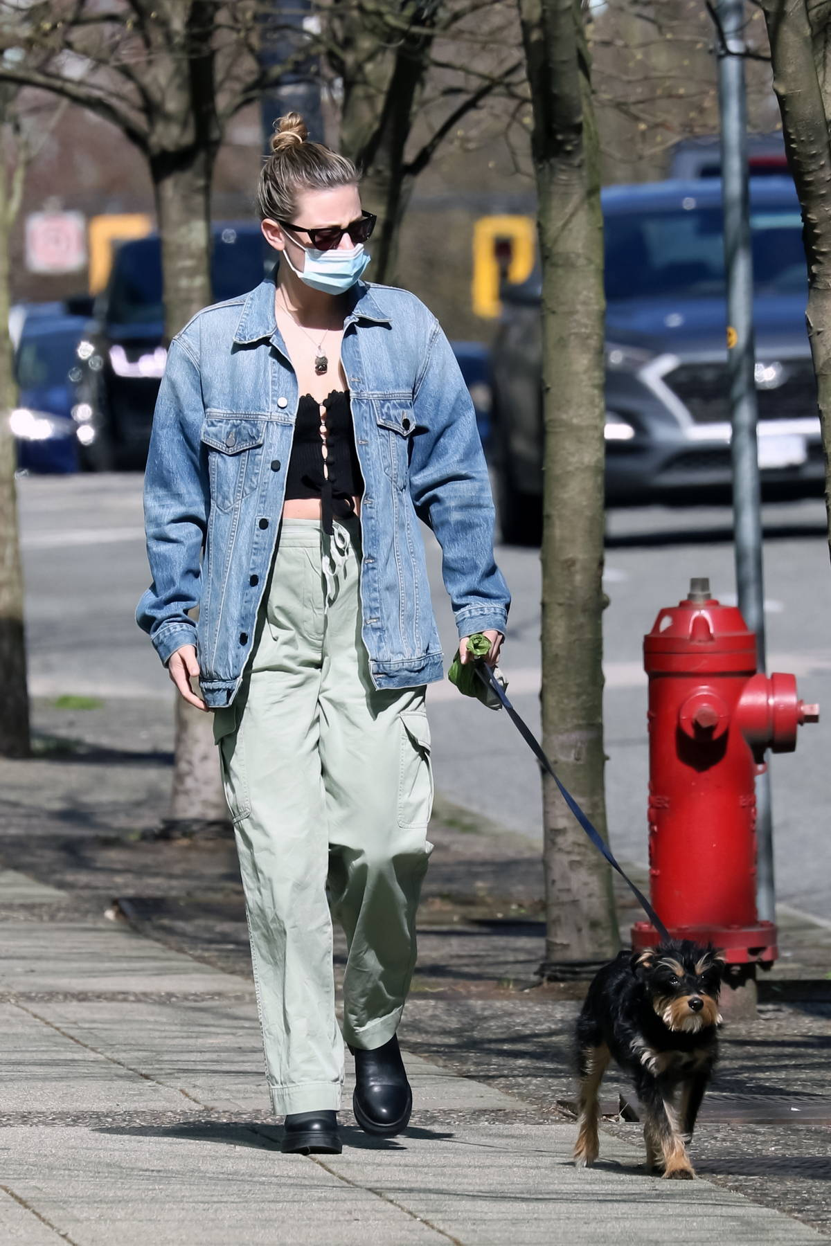 Lili Reinhart steps out to walk her wearing a denim jacket and light green pants in Vancouver, Canada