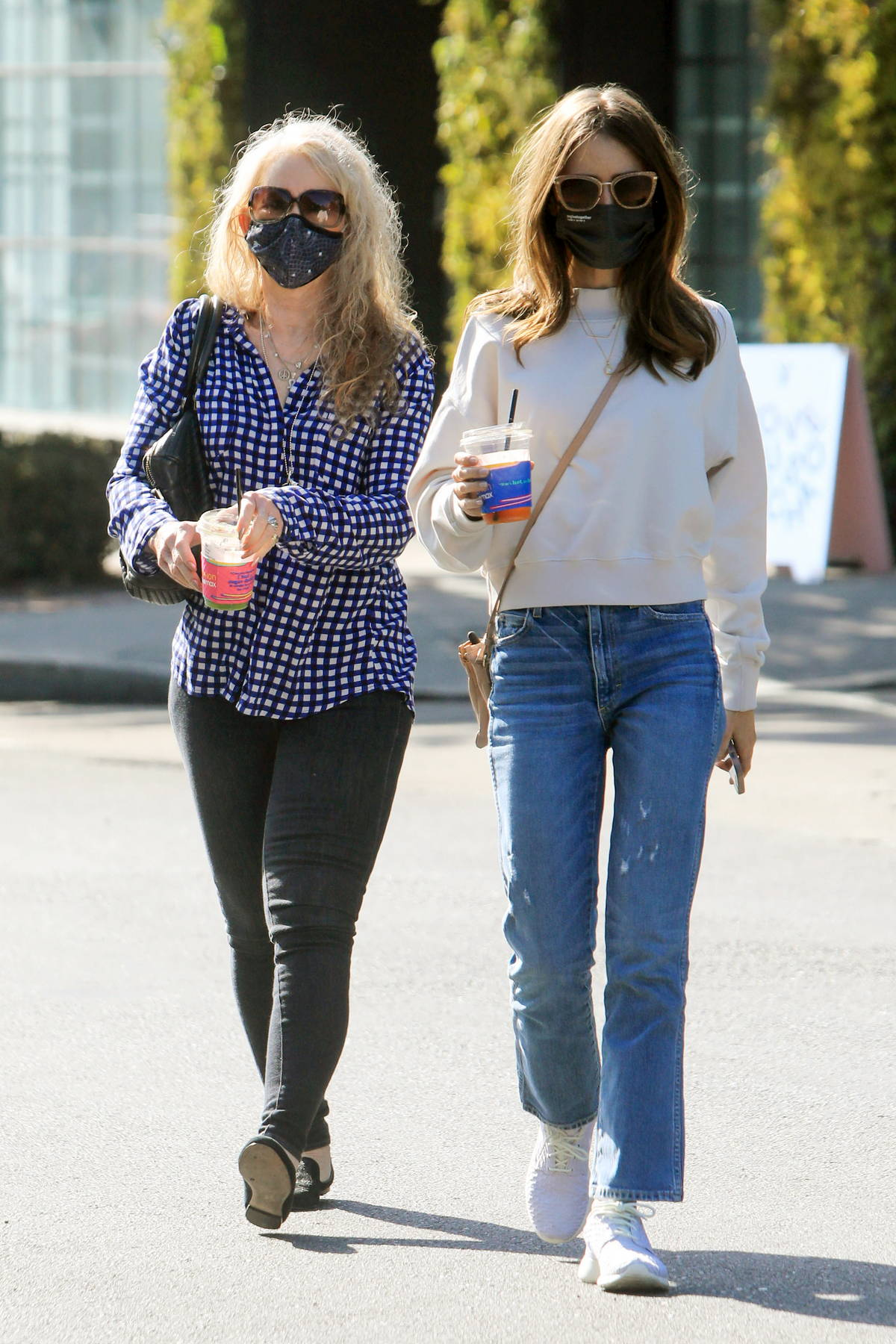 Lily Collins takes her Mom out for lunch to celebrate her birthday in West Hollywood, California