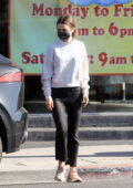 Lily Collins wears a white sweatshirt and black denim while out running errands in Los Angeles