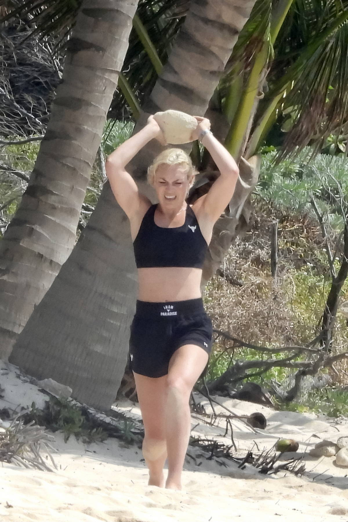 Lindsey Vonn sweats it out with a grueling beach workout session during her vacation in Tulum, Mexico