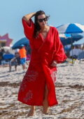 Liv Tyler seen wearing a red robe while enjoying an afternoon with her family at the beach in Miami Beach, Florida