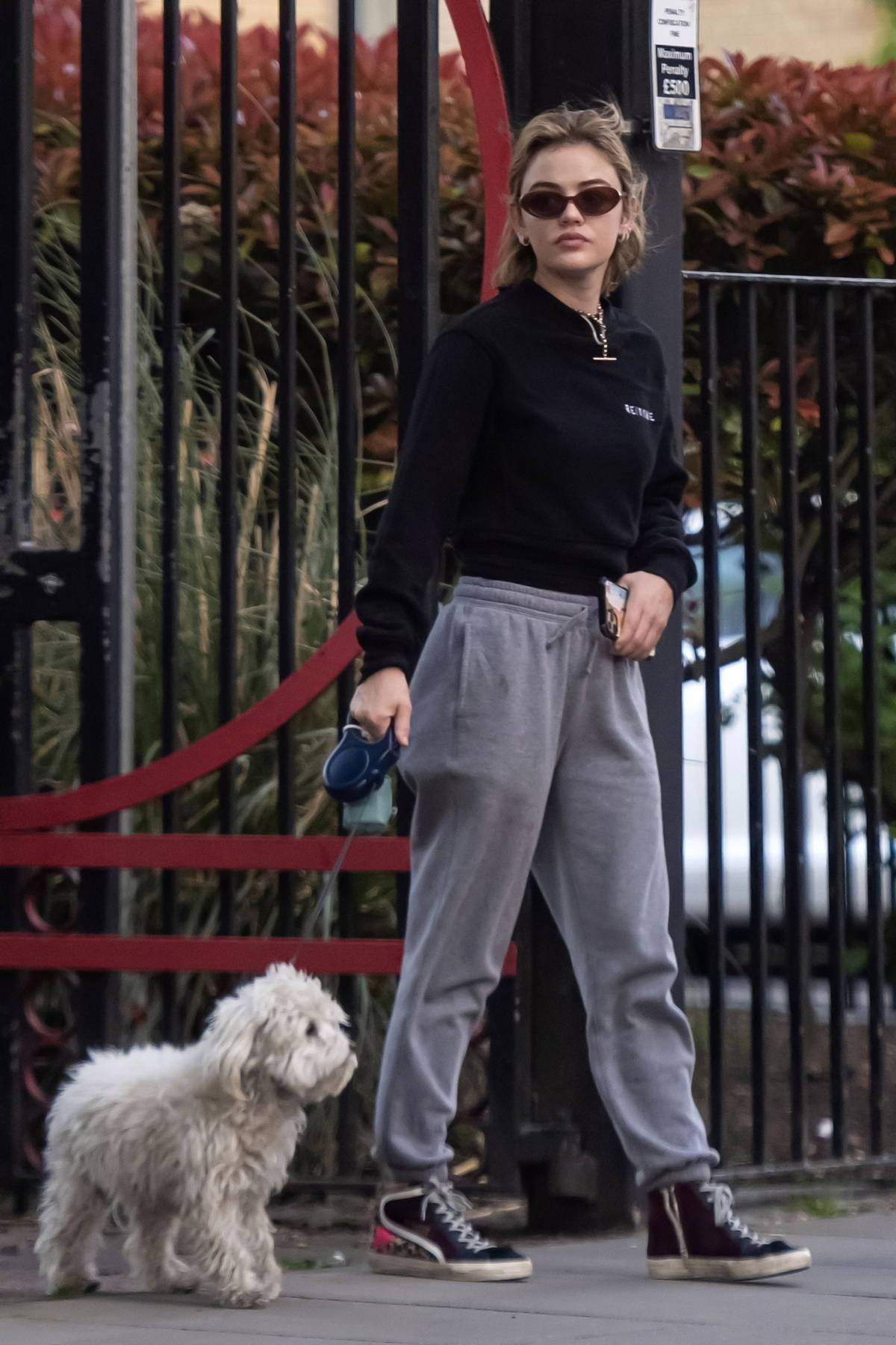 Lucy Hale stays comfy in sweats as she steps out to walk her dog Elvis in London, UK
