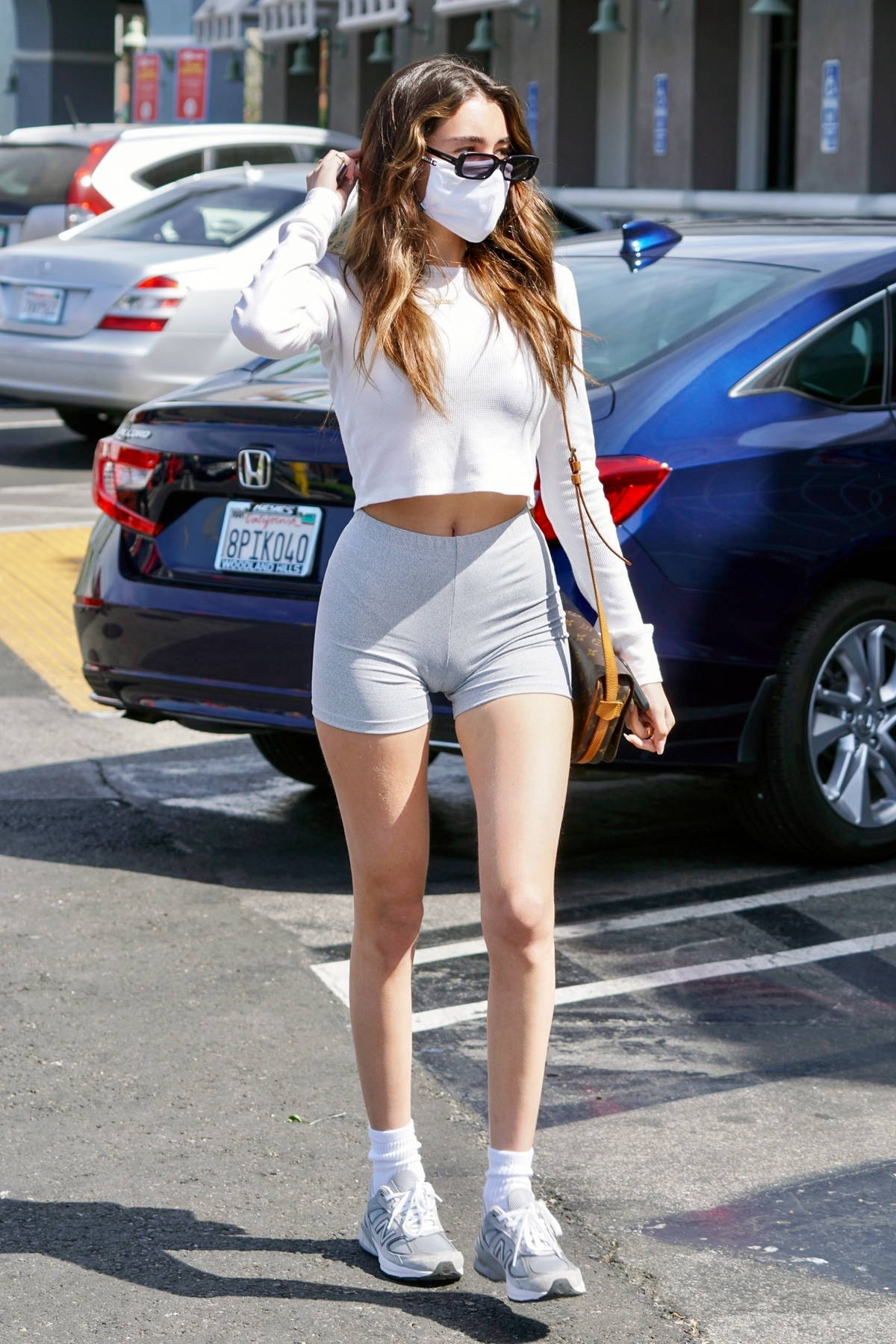 Madison Beer shows off her taut figure in tiny grey shorts while out for lunch with Nick Austin in West Hollywood, California