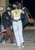 Madison Beer wears a cropped white tee and jeans for a dinner outing at Nobu in Malibu, California