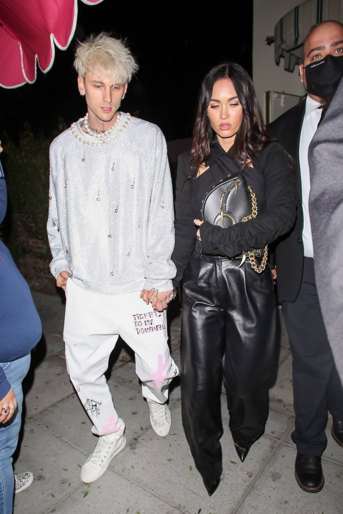 Megan Fox and Machine Gun Kelly hold hands as they leave after a night out at Delilah in Los Angeles