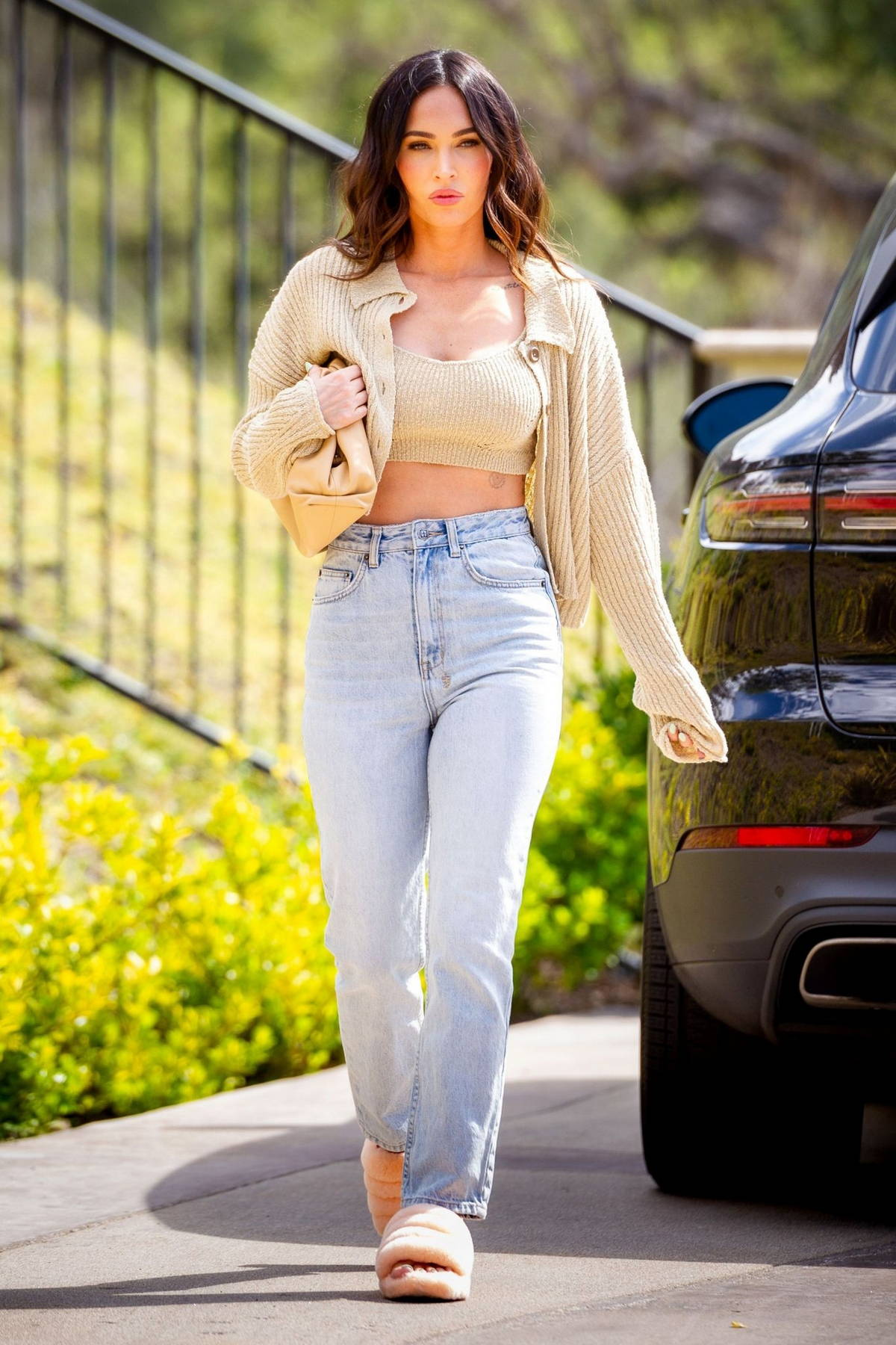 Megan Fox looks fab in a crop top with matching cardigan as she steps out in Los Angeles
