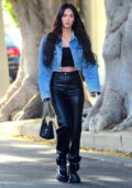 Megan Fox rocks a denim jacket and black leather pants as she leaves a salon in West Hollywood, California
