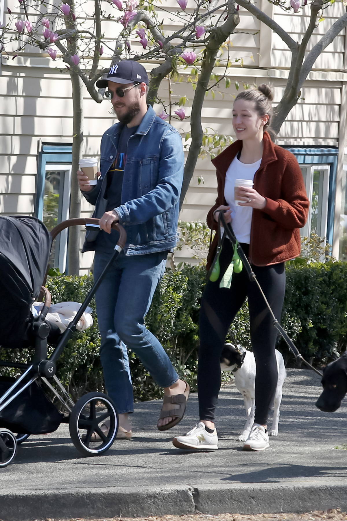 Melissa Benoist and Chris Wood step out for a stroll with their baby and the dogs in Vancouver, Canada