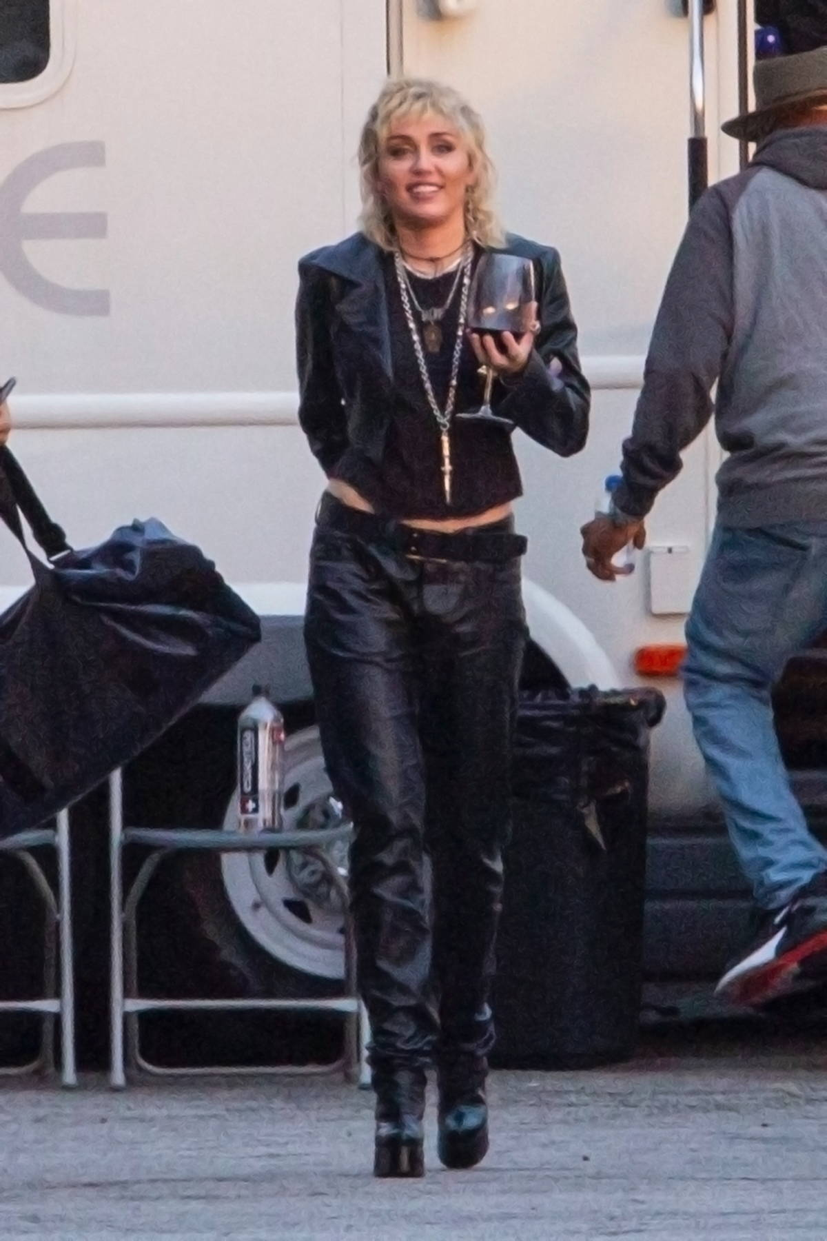 Miley Cyrus sips on some wine after a photoshoot at a studio in Burbank, California