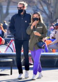 Nina Agdal stands out in bright purple sweatpants while out on a stroll with a friend at Washington Square Park in New York City