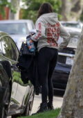 Nina Dobrev wears a hoodie and leggings as she arrives home after a workout session in Los Angeles