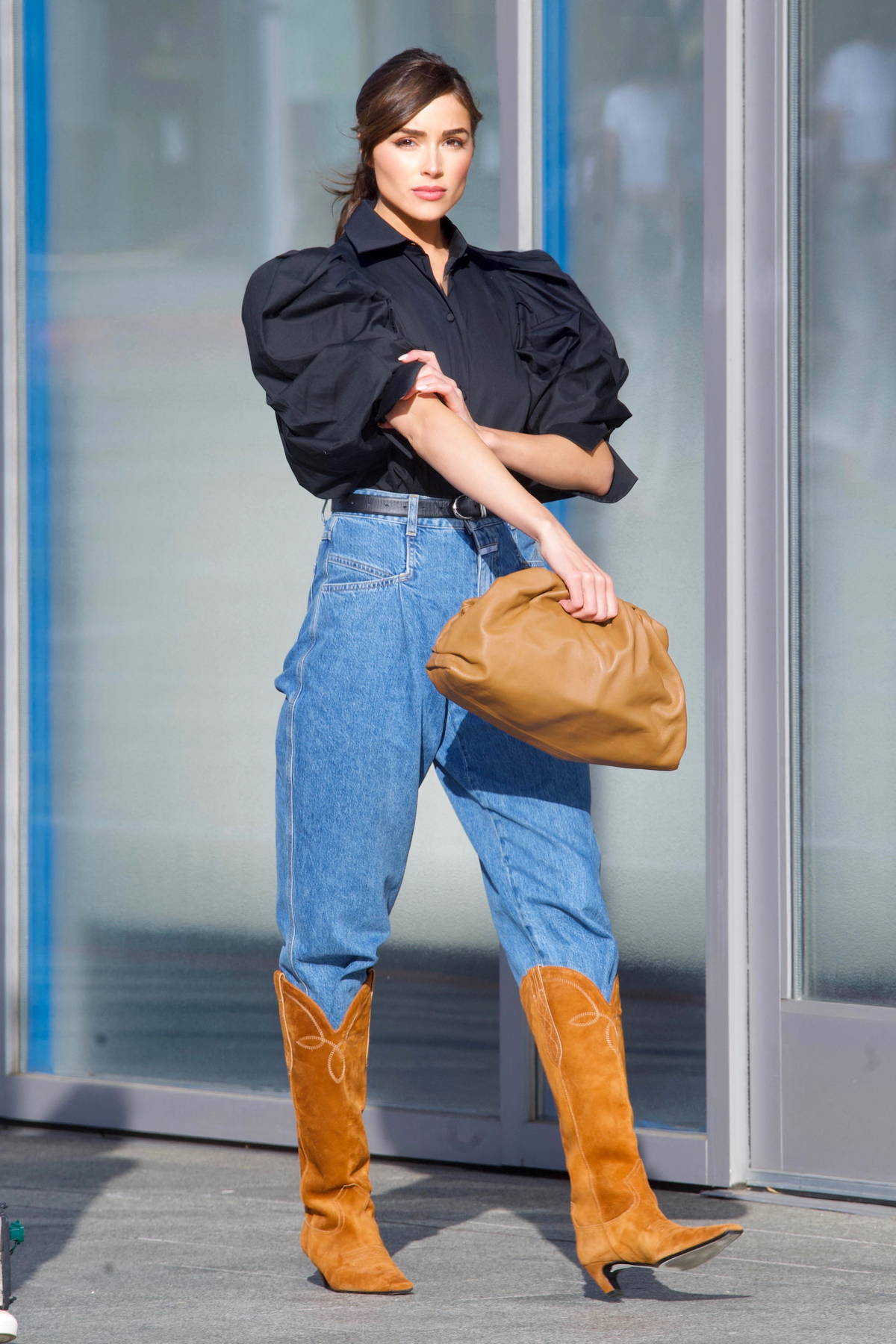 Olivia Culpo looks stunning a frilly black shirt and high-waisted jeans while out shopping at Valentino in Beverly Hills, California