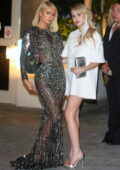Paris Hilton and Maria Bakalova cause a flash frenzy at an 2021 Oscar party at Sunset Tower in Los Angeles