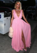 Paris Hilton is pretty in pink while out for dinner with her fiancé at Craig's in West Hollywood, California