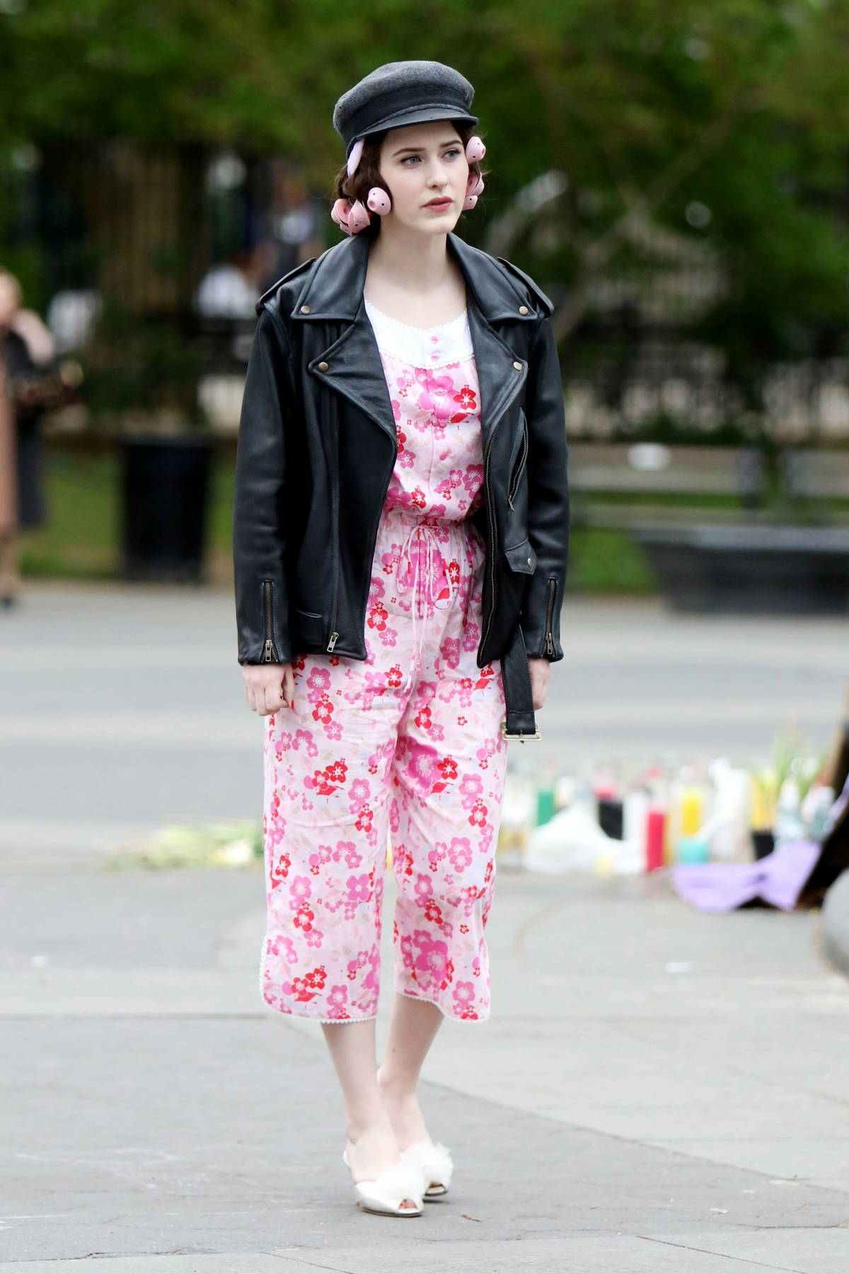 Rachel Brosnahan looks pretty in pink while on the set of the Marvelous Mrs. Maisel at Washington Square Park in New York City