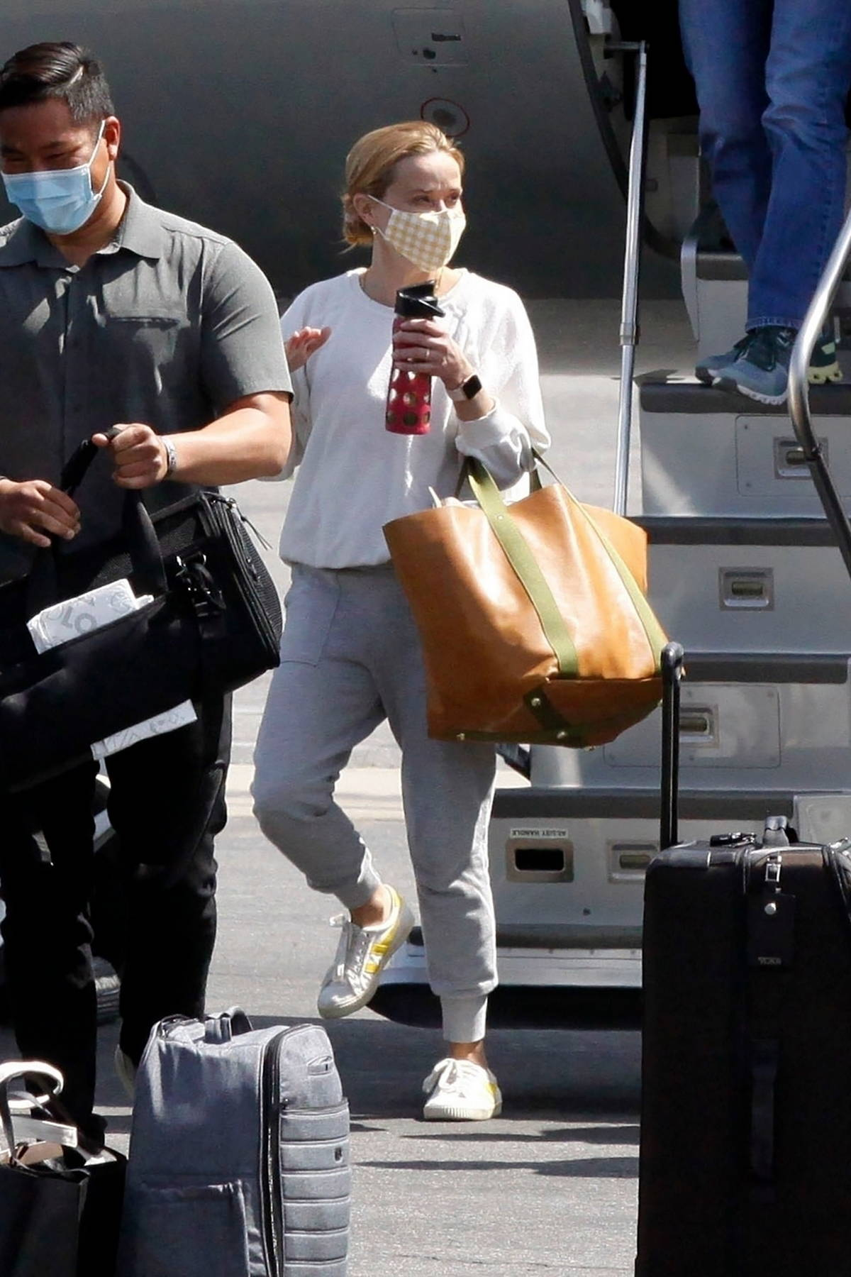 Reese Witherspoon keeps it comfy in sweats as she touches down in Los Angeles on a private jet, Los Angeles
