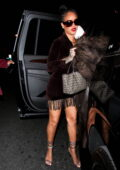 Rihanna flaunts her legs in a brown fringe mini dress and strappy heels during a night out at Delilah in West Hollywood, California