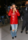 Rihanna looks striking in a bright red leather jacket as she arrives for dinner at Nobu in New York City
