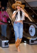 Rihanna looks stylish in a fur hat with matching feathered jeans while shopping at book store in Los Angeles