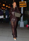 Rihanna rocks a brown leather jacket with sheer pants as she celebrates her Mom's birthday at Pastis in New York City