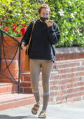 Riley Keough chats on her phone with a bandage on her nose while visiting a medical office in Beverly Hills, California