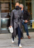 Rosie Huntington-Whiteley dons a black leather trench coat as she leaves the Crosby hotel in New York City
