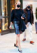 Rosie Huntington-Whiteley heads out in a black leather skirt and a fuzzy sweater in New York City